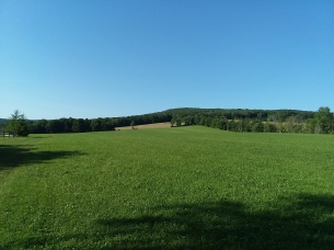 Passing by the middle field, with cutting resumed in distance.